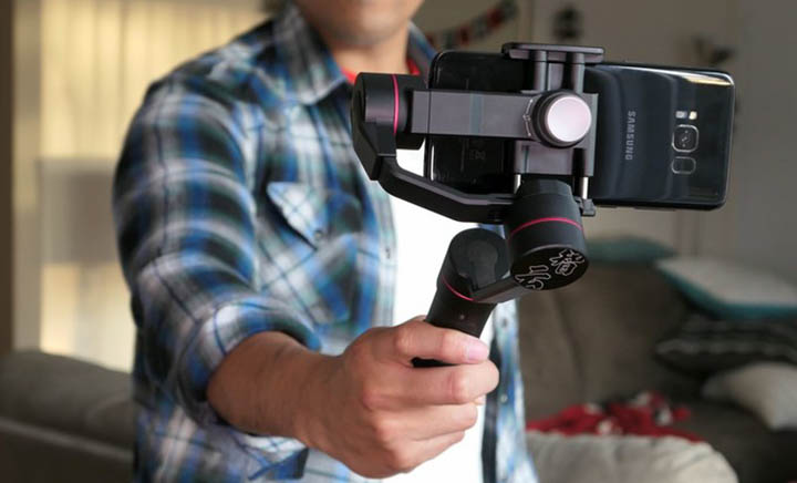 Have a Gimbal for your phone. This is to provide better stabilization for your phone cam.